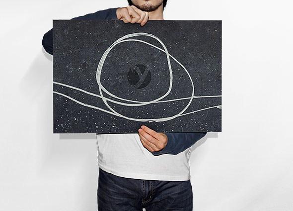 man_holding_paper_mockup