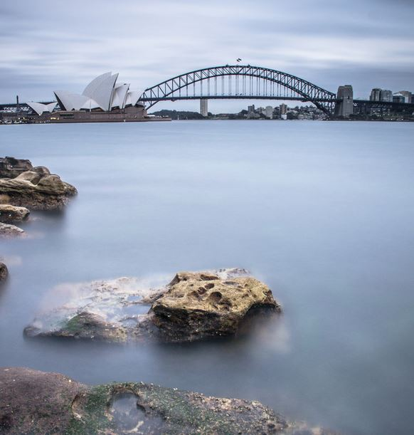 Sydney Harbour Bridge with silky water and neutral color tones