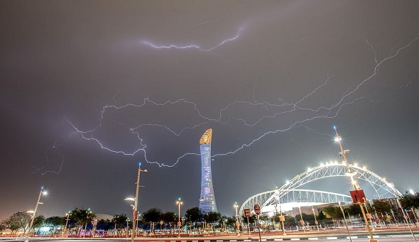 night exposure photography of thunderstorms with city lights on