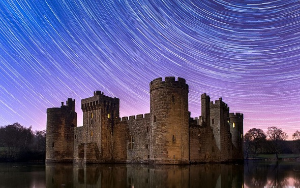 Bodiam castle in England with star trails