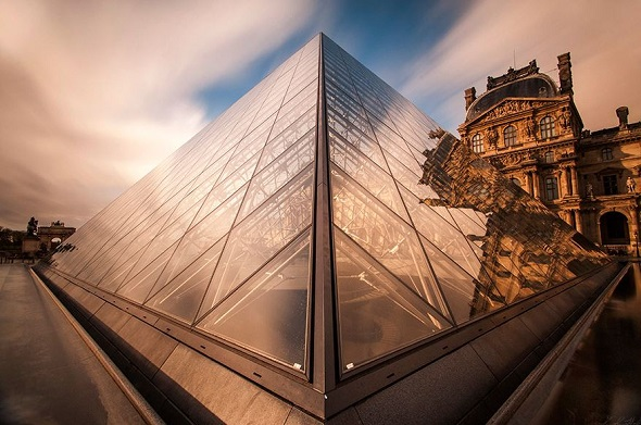 Louvre Palace with foggy clouds
