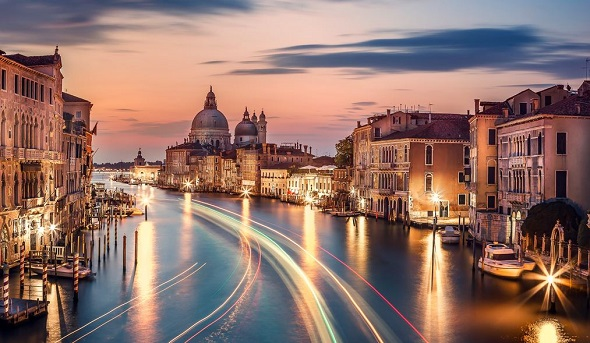 boat trails with awesome light effects on grand canal of Venice