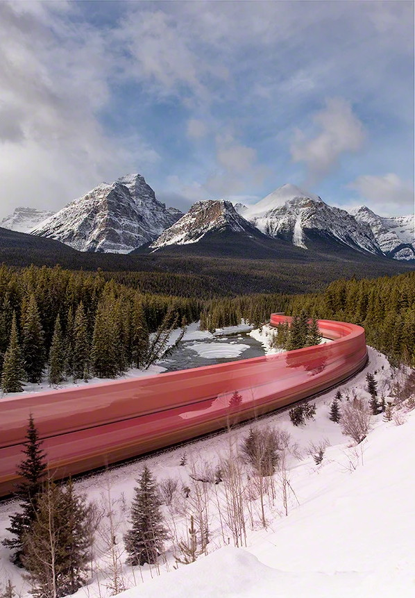 evergreen train trail at Canadian Rockies with ice and mountains
