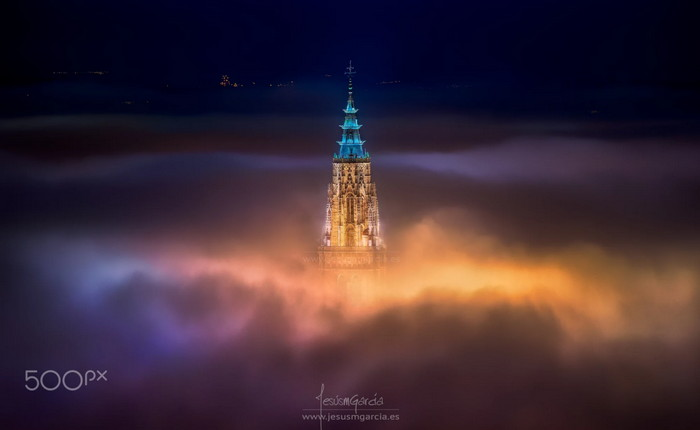 Toledo City cathedral filled with foggy clouds