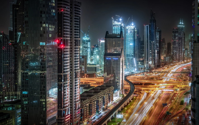 busy highway with vehicle trails in Dubai city After Sunset