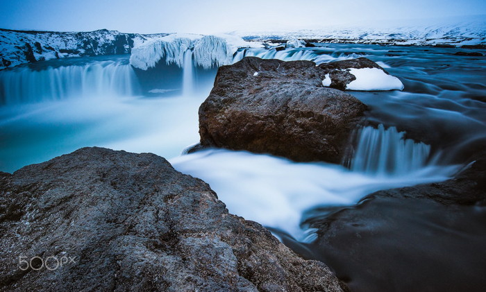 godafass waterfalls with icy waters